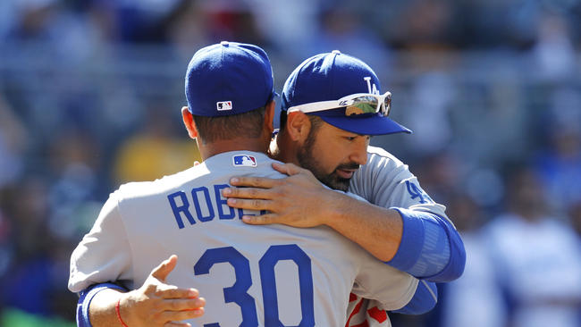 Adrian Gonzalez hugs Dave Roberts