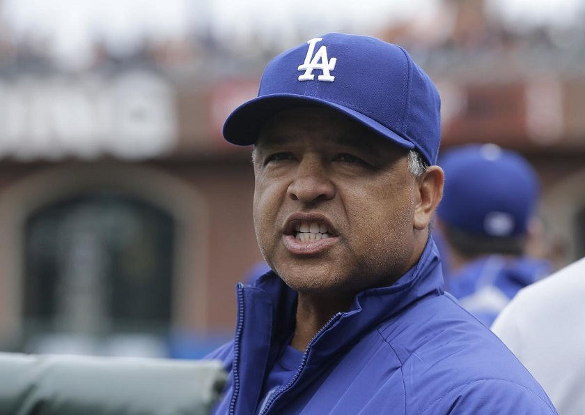 Los Angeles Dodgers manager Dave Roberts watches during the fifth inning of a baseball game between the San Francisco Giants and the Dodgers in San Francisco, Saturday, April 9, 2016. (AP Photo/Jeff Chiu)