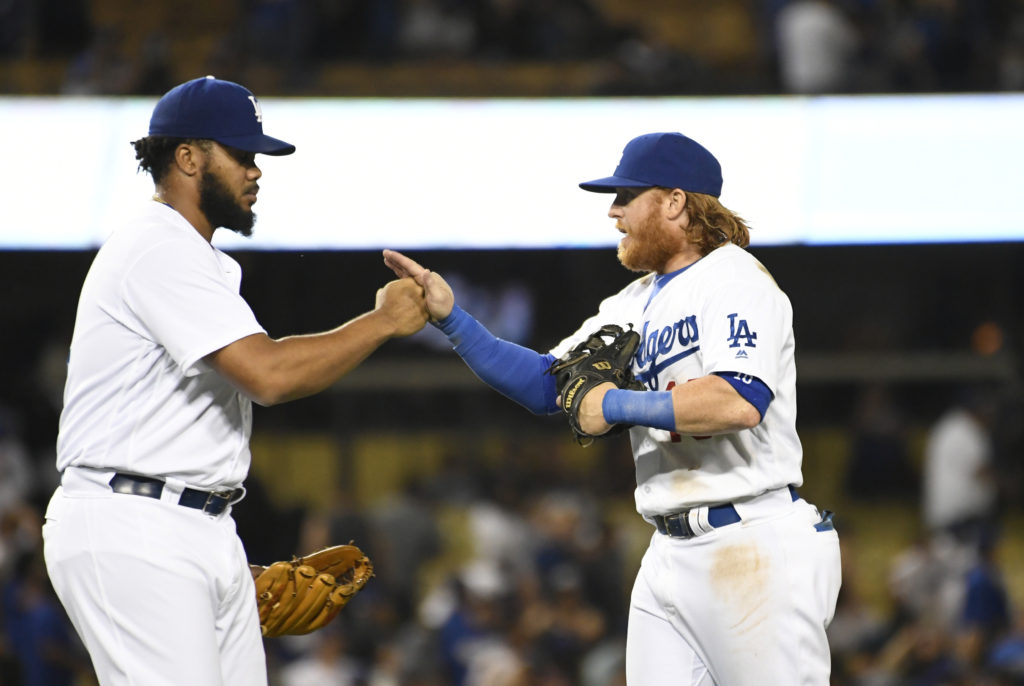 Aug 23, 2016; Los Angeles, CA, USA;  Los Angeles Dodgers relief pitcher Kenley Jansen (74) and third baseman Justin Turner (10) celebrate their 9-5 win over the San Francisco Giants at Dodger Stadium. Mandatory Credit: Richard Mackson-USA TODAY Sports